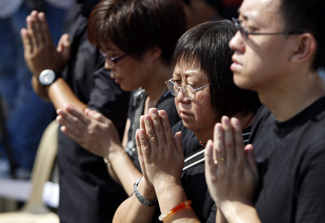STILL WAITING. In this 2011 file photo, relatives of the 8 dead Hong Kong nationals attend a ceremony at the Quirino grandstand, the site of the hostage-taking tragedy. File photo by EPA/Dennis M Sabangan