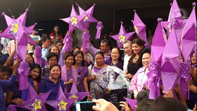 'PURPLE CHRISTMAS.' RH advocates led by the Reproductive Health Advocate Network visit the Senate to give u0022RH nowu0022 lanterns to RH sponsors Sen Pia Cayetano and Sen Miriam Defensor Santiago. Former Health Secretary Alberto Romualdez was also present. Photo by Ayee Macaraig