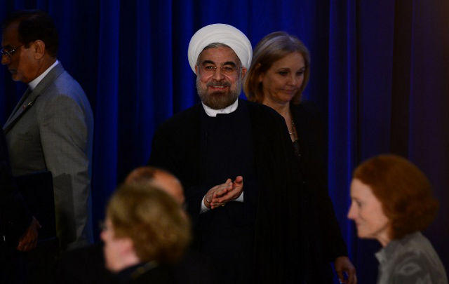 IN GOOD FAITH. Iran's President Hassan Rouhani arrives to give a speech at an Asia Society event on the sidelines of the 68th United Nations General Assembly, in New York, September 26, 2013. AFP PHOTO/Emmanuel Dunand