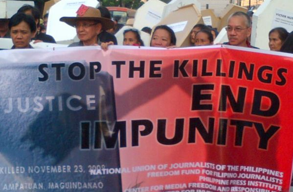 END IMPUNITY. Participants carried mock coffins and banners calling for an end to impunity. Photo from official CMFR Twitter account.