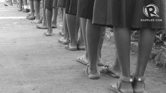 SLIPPERS. The girls fall in line for the flag ceremony. Photo by Jee Geronimo/Rappler
