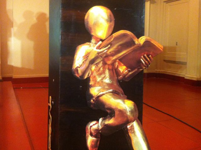 BOOK PRIZE. The National Book Awards trophy was designed by Michael Allen Cacnio, a world-class brass sculptor of the social realist genre