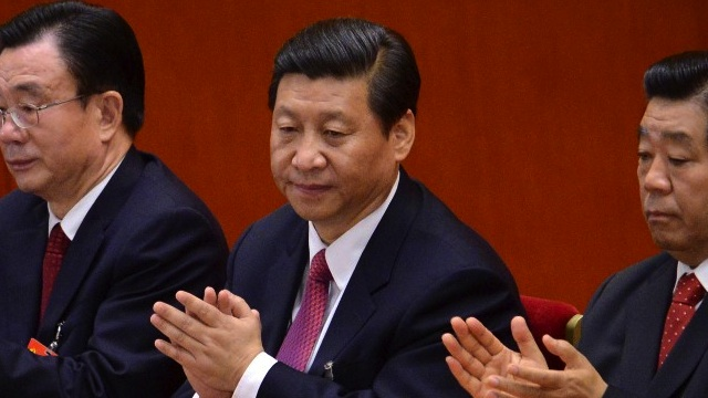 LEADER-IN-WAITING. Chinese Vice President Xi Jinping (C) applauds during the closing of the 18th Communist Party Congress at the Great Hall of the People in Beijing on 14 November 2012. AFP PHOTO/WANG ZHAO