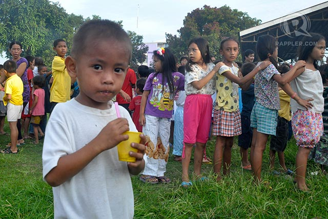 BACK TO SCHOOL? Children from evacuation centers line up for the ceremonial opening of schools. Photo by LeAnne Jazul/Rappler