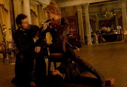ENEMIES OF THE STATE. Rufus Sewell and Erin Wasson pin Benjamin Walker to the floor
