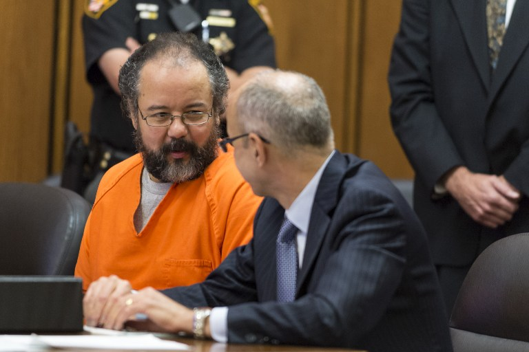 In this file photo, Ariel Castro (L) talks with his lawyer during a break in his trial on August 1, 2013 in Cleveland, Ohio. Angelo Merendino/Getty Images/AFP