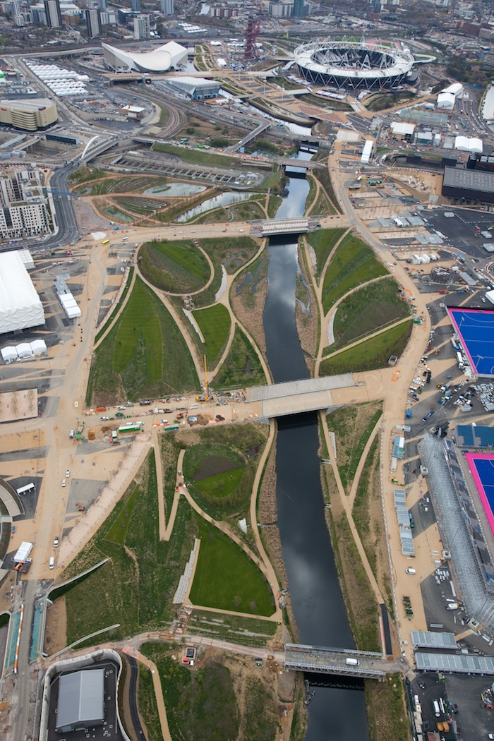 FROM ABOVE. Aerial view of the Olympic Park showing the Parklands looking south towards the Olympic Stadium and Aquatics Center. Courtesy of LOCOG.
