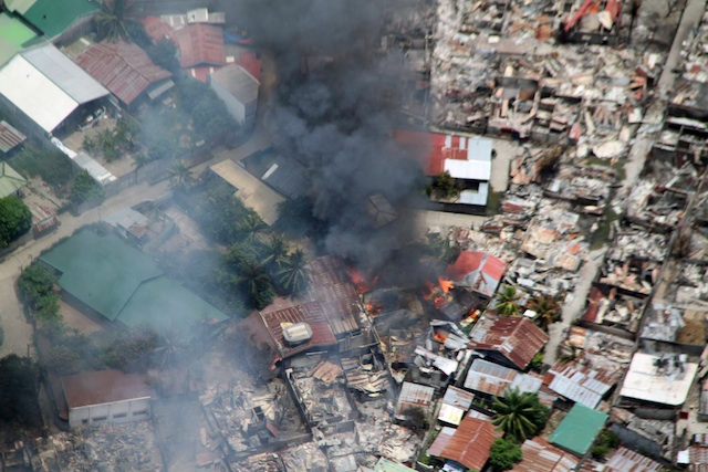 URBAN WAR: Military says MNLF rebels are hiding in the debris. File photo from the Philippine Air Force