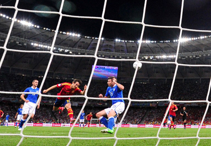 FIRST GOAL: Spanish midfielder David Silva heads the ball to score the first goal of the final.