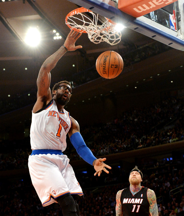 THROWING IT DOWN. New York Knicks Amar'e Stoudemire throws down an emphatic dunk as Miami Heat Chris Andersen can only look on Thursday, Jan. 9 at Madison Square Garden. The Knicks won 102-92. Photo by Justin Lane/EPA