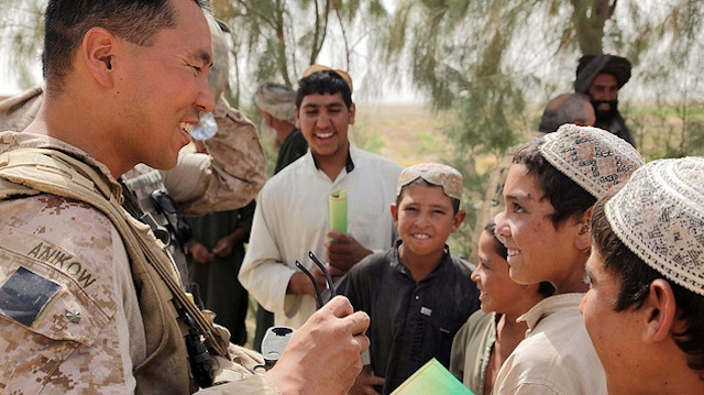 MILITARY MAN. Maj Anikow (L) served in Afghanistan helping develop relationships between the US military and the local population. Photo courtesy of US Marine Cops official Flickr photostream