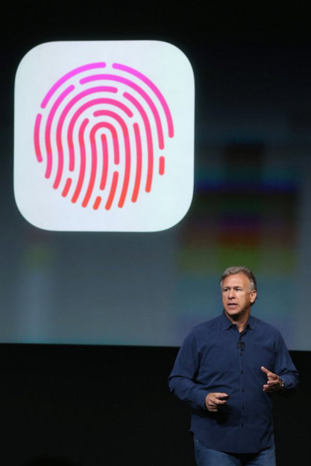 APPLE'S TOUCHID. Apple Senior Vice President of Worldwide Marketing Phil Schiller taks about Touch ID - a security feature of the new iPhone 5S. Photo by Justin Sullivan/Getty Images/AFP