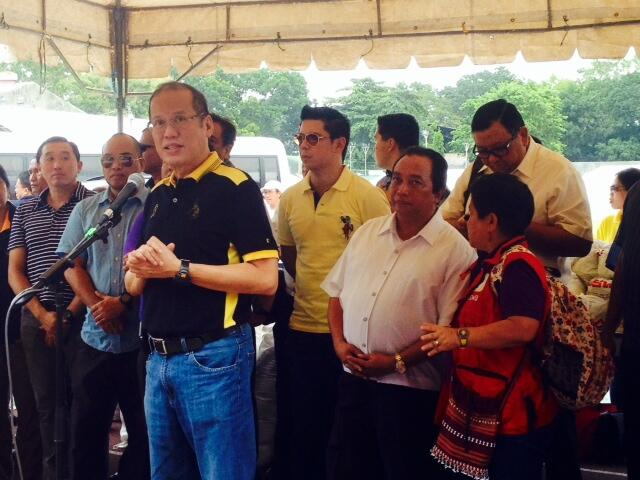 ASSURANCE. President Benigno Aquino III (3rd L) speaks to evacuees at the CPG Sports Complex in Tagbilaran City, Bohol, 16 October 2013. Photo courtesy of the DSWD Twitter account @dswdserves