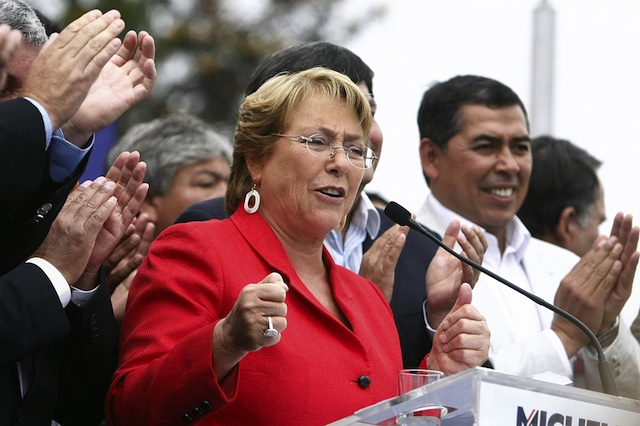 FRONTRUNNER. Former president Michelle Bachelet (L), delivers a speech in the San Ramon neighborhood in Santiago, Chile, 18 November 2013. EPA/Mario Ruiz