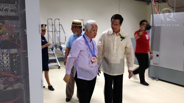 QUALITY CHECK. Comelec Chair Sixto Brillantes Jr and NPO director Emmanuel Andaya tour the 5,000-square meter facility. Photo by Paterno Esmaquel II