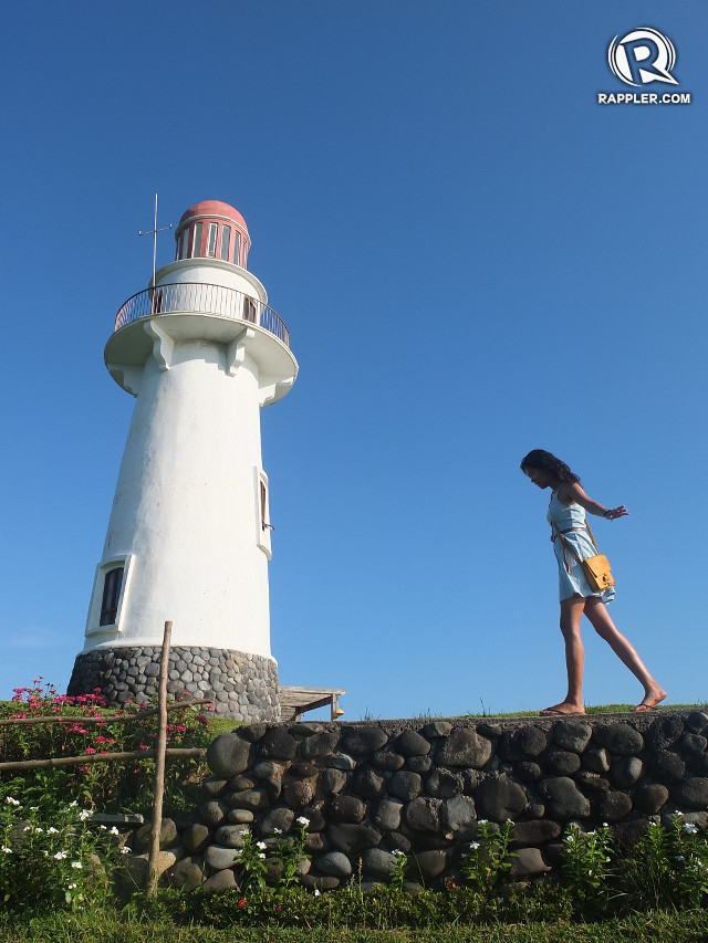 BASCO LIGHTHOUSE. The author's sister walks the stone fence bordering the Basco lighthouse site