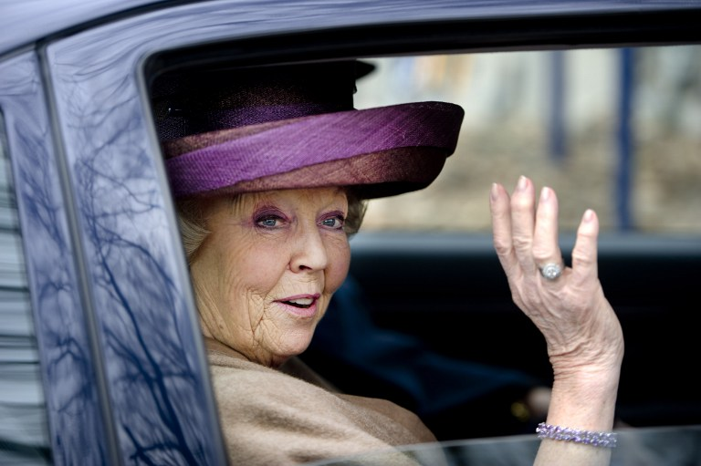 STEPPING DOWN. In this photo taken on April 3, 2012 Queen Beatrix leaves after the opening of an attraction at the Arnhem Open Air Museum in Arnhem. AFP PHOTO/ANP ROYAL IMAGES / ROBIN UTRECHT