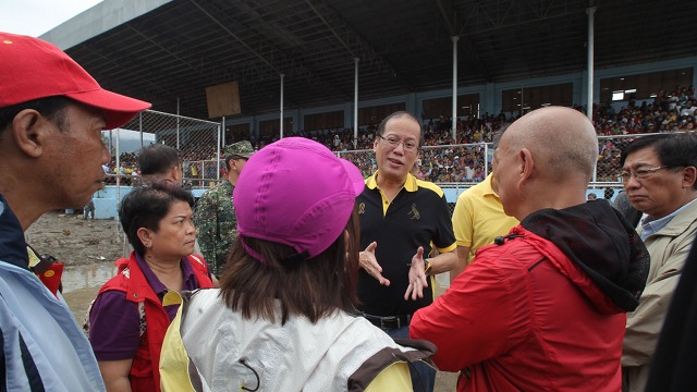 WANTING ANSWERS. President Aquino orders an investigation of local government's disaster response after visiting Compostela Valley and Davao Oriental. Aquino observed that evacuation centers were built in flood-prone areas. Photo by Malacau00f1ang Photo Bureau