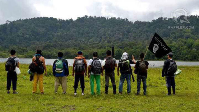 BLACK FLAG. Filipinos carry the black flag in the southern Philippines. Sourced by Rappler