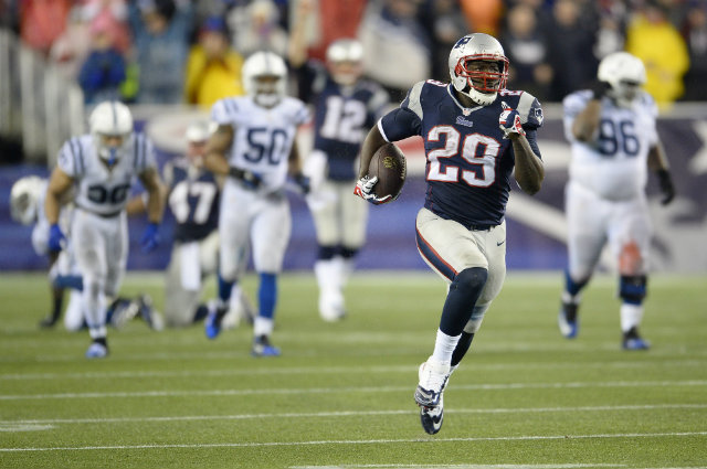 GONE WITH THE WIND. New England Patriots running back LeGarrette Blount one his way towards 73-yard touchdown run against the Indianapolis Colts on Saturday, Jan. 11 at Gillette Stadium in Foxborough, Mass. The Patriots won 43-22 to advance to their third consecutive AFC championship game. Photo by CJ Gunther/EPA