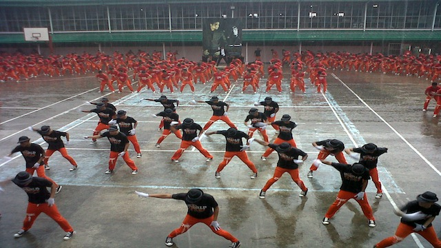 DANCIN' IN THE RAIN. Inmates at the Cebu Provincial Detention and Rehabilitation Center perform their version of Py's Gangnam Style before a crowd of tourists. Photo taken by Ryan Christopher J. Sorote