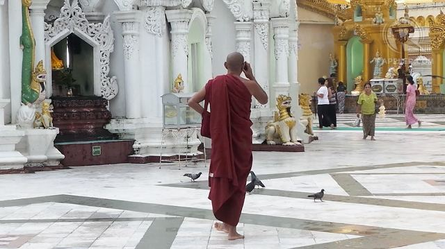 GOING MOBILE. A monk speaks on his mobile phone in Myanmar's iconic Shwedagon Pagoda. The country is expecting a boom in Internet and smartphone use after the government awarded licenses to two foreign telecommunication firms. Photo by Rappler/Ayee Macaraig, 2013 SEAPA Fellow