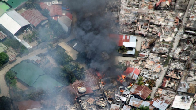 BURNED HOUSES: In the end, over 10,000 houses were damaged inside the Zamboanga City combat zone. File photo courtesy of the Philippine Air Force