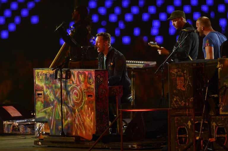 COLDPLAY LIVE. Chris Martin, Guy Berryman, Jon Buckland and Will Champion of British rock band Coldplay perform during the closing ceremony of the London 2012 Paralympic Games at the Olympic Stadium in east London on September 9, 2012. AFP PHOTO / ADRIAN DENNIS