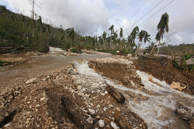 ROAD TO RIVER. A portion of the Cateel-Compostela road was transformed into a small waterfall. Photo by Karlos Manlupig.