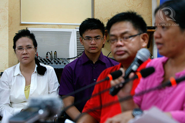 INDEFINITE LEAVE: Dismissed PMA cadet Aldrin Jeff Cudia (center) listens as his mother talks during a press conference inside the Public Attorneys Office in Quezon City. Photo by Ben Nabong/Rappler