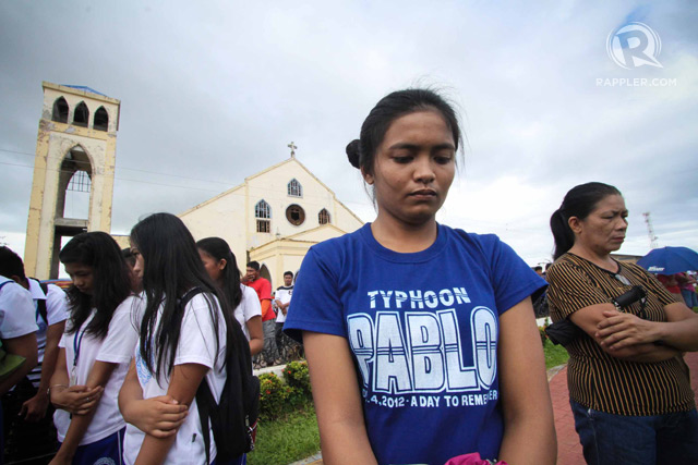 MOMENT OF SILENCE. Residents of Cateel, Davao Oriental observe a moment of silence on the first anniversary of Super Typhoon Pablo (Bopha), 4 December 2013. Photo by Karlos Manlupig/Rappler