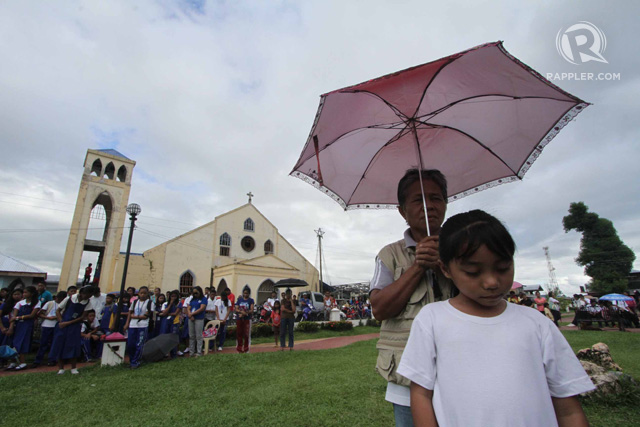 SURVIVORS. Residents of Cateel, Davao Oriental infront of the town church during the commemoration of the first anniversary of Super Typhoon Pablo, 4 December 2013. Photo by Karlos Manlupig/Rappler