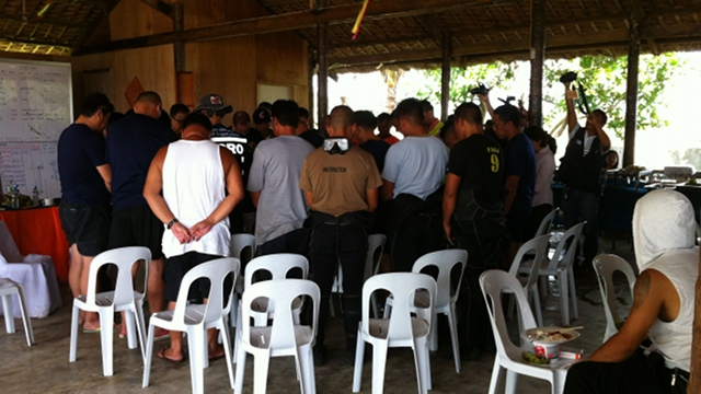 Divers said a prayer in the Task Force Kalihim headquarters before going out to sea to find the bodies of the two pilots. File photo by Ayee Macaraig