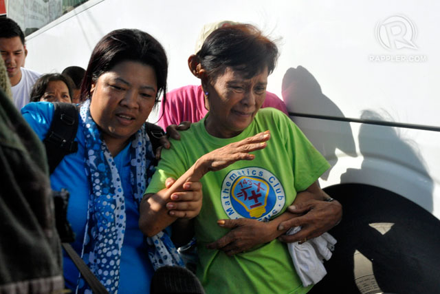 FREEDOM. Social workers assist former hostages to a vehicle that will take them to Camp Batalla for processing, September 17, 2013. Photo by LeAnne Jazul/Rappler