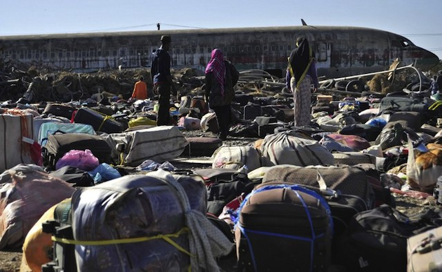 BACK HOME. Ethiopian immigrants returning from Saudi Arabia searching for their luggages among unclaimed bags at Addis Ababau2019s Bole International Airport, December 10, 2013. AFP/Jenny Vaughan