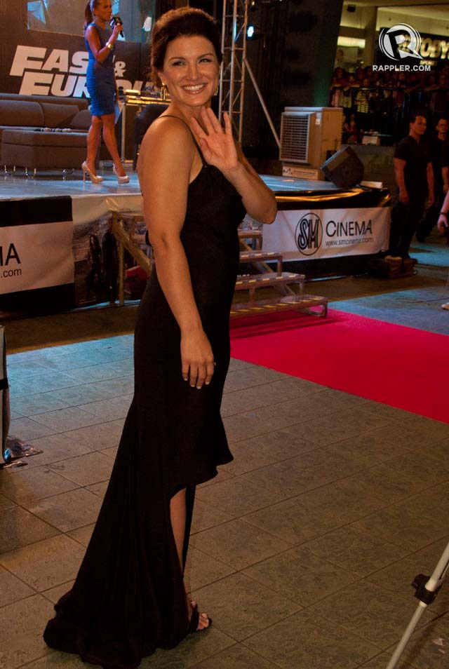 LOVELY LADY. MMA fighter Gina Carano shows her dainty, feminine side in a slit black gown