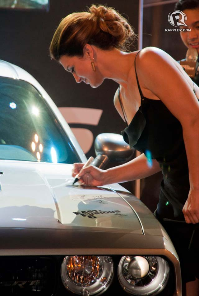 GINA'S TURN. Hard to find a Chrysler Dodge with an MMA fighter's signature on it