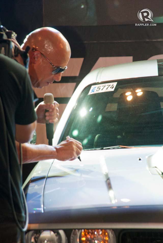 BEST FOR LAST. Vin Diesel revs up the ride by signing it