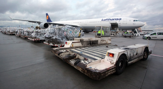 FOR SURVIVORS. Cartloads of relief aid for the victims of super typhoon Haiyan (Yolanda) that has struck the Philippines stand next to a Lufthansa aircraft at Frankfurt International Airport, Frankfurt am Main, Germany, 10 November 2013. EPA/Fredrik von Erichsen