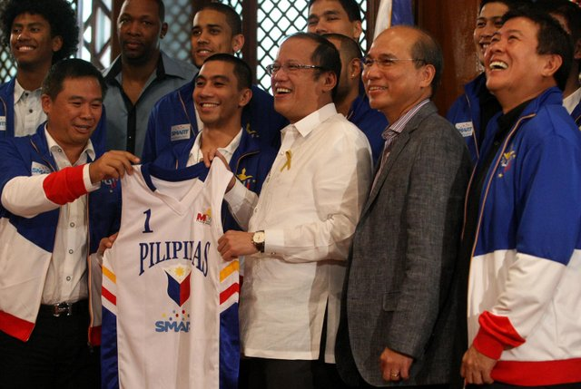 President Benigno S. Aquino III receives a Smart Gilas Pilipinas basketball jersey during the courtesy call of the members of the basketball team champion in the 34th William Jones Cup at the President's Hall, Malacanang Palace. Photo by: Robert Viu00f1as/ Malacanang Photo Bureau