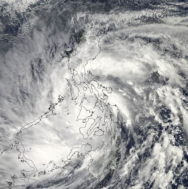 MEGASTORM. As Super-Typhoon Haiyan moved over the central Philippines on Nov. 8 at 05:10 UTC/12:10 a.m. EDT, the MODIS instrument aboard NASA's Aqua satellite captured this visible image. Photo courtesy NASA Goddard MODIS Rapid Response Team