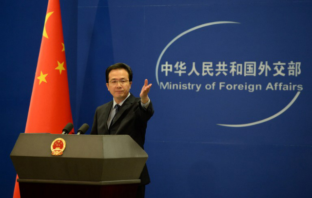 'RESOLVE' THE CASE. Chinese Foreign Ministry spokesman Hong Lei confirms that the Philippines detained 78 Chinese nationals in an immigration crackdown. File photo by AFP