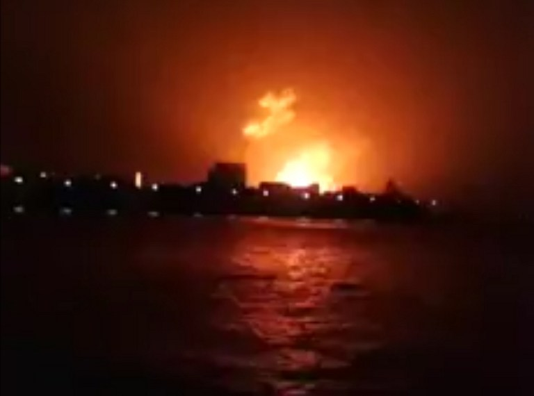 FIRE AT THE DOCK. This frame grab taken from video footage provided by Indian broadcaster NWS early on August 14, 2013, shows a fire at the Indian Naval Dockyard in Mumbai. AFP/NWS