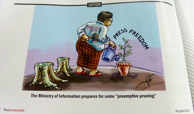 An editorial cartoon of The Irrawaddy newsmagazine in August on the controversy surrounding the Ministry of Information's printing and publishing enterprise bill. Photo by Rappler/Ayee Macaraig, 2013 SEAPA Fellow