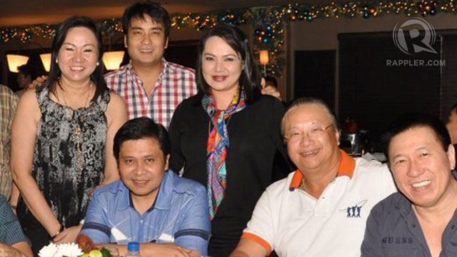 A PARTY. Janet Lim-Napoles, left (standing), rubs elbows with senators Jinggoy Estrada and Bong Revilla in this photo taken during a party in Estrada's favorite hangout in San Juan. The man second from right is businessman Jaime Dichaves, who has owned to the Jose Velarde account initially linked to former President Joseph Estrada.