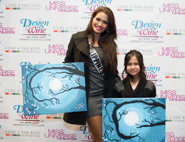 CARING BEAUTY QUEEN. Miss Philippines Janine Tugonon and Maria pose with their artwork. Photo posted on the Janine Mari Raymundo Tugonon Facebook page