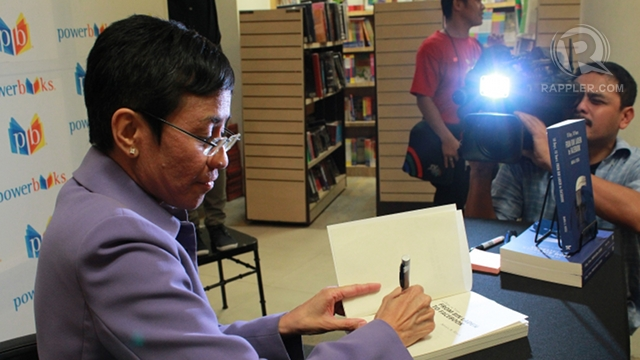 STILL ROLLING. As in captivity, ABS-CBN cameraman Jimmy Encarnacion rolls his camera, this time documenting the book launch of his former boss, Maria Ressa. In the book, Ressa described him as a u0022fantastic, artistic shooter.u0022 Photo by Hoang Vu.