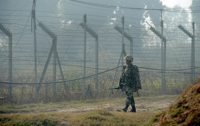 DISPUTED. In this file photo, an Indian Border Security Force (BSF) soldier patrols along the border fence at an outpost along the India-Pakistan border in Suchit-Garh, 36 kms southwest of Jammu on January 10, 2013. Photo by AFP/Tauseef Mustafa