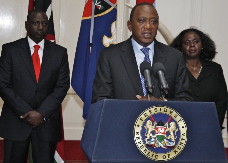 ATTACK OVER. Kenyan President Uhuru Kenyatta (C) speaking during a press conference in Nairobi in front of Kenyan Vice President William Ruto (L) following an attack on the Westgate shopping mall in Nairobi, September 24, 2013. AFP / Kenya Presidential Press Service