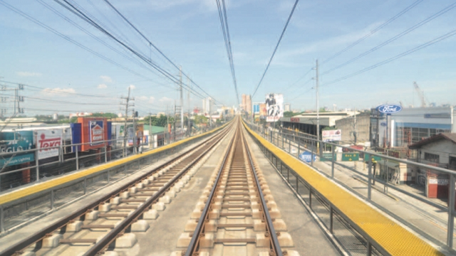 LRT. The P9.35-B bid of Light Rail Manila Consortium of Pangilinan-led Metro Pacific and Ayala and Macquarie groups is opened in June 2014. File photo from the PPP Center